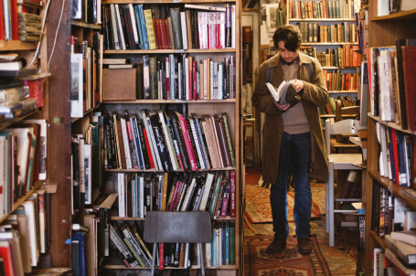 Man browsing in bookshop